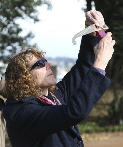 A woman holds a pair of solar viewing glasses to her mobile phone to photograph Venus passing the sun at the Sydney Observatory in Sydney, Australia, Wednesday, June 6, 2012. From the U.S. to South Korea, people around the world turned their attention to the daytime sky on Tuesday and early Wednesday in Asia to make sure they caught the rare sight of the transit of Venus. The next one won&#39;t be for another 105 years.&#40;AP Photo&#47;Rob Griffith&#41; <span class=meta>(AP Photo&#47; Rob Griffith)</span>