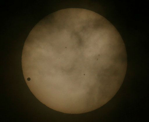 Venus passes in front of the sun, as visible from Hong Kong, Wednesday, June 6, 2012. From the U.S. to South Korea, people around the world turned their attention to the daytime sky on Tuesday and early Wednesday in Asia to make sure they caught the once-in-a-lifetime sight of the transit of Venus.&#40;AP Photo&#47;Vincent Yu&#41; <span class=meta>(AP Photo&#47; Vincent Yu)</span>