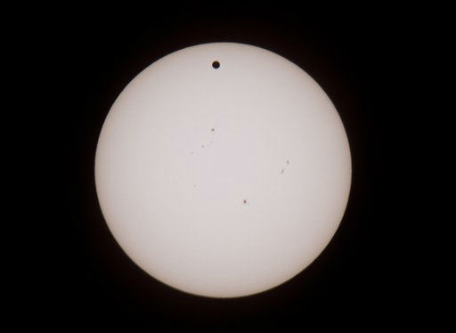 "<div class=""meta image-caption""><div class=""origin-logo origin-image ""><span></span></div><span class=""caption-text"">The larger black dot, top center, is the planet Venus as it transits across the face of the Sun as viewed from Earth, as seen through a Solar filter at the Givatayim Observatory near Tel Aviv, Israel, Wednesday, June 6, 2012. Observers on seven continents, even a sliver of Antarctica, will be in position to see it. (AP Photo/Ariel Schalit) (AP Photo/ Ariel Schalit)</span></div>"