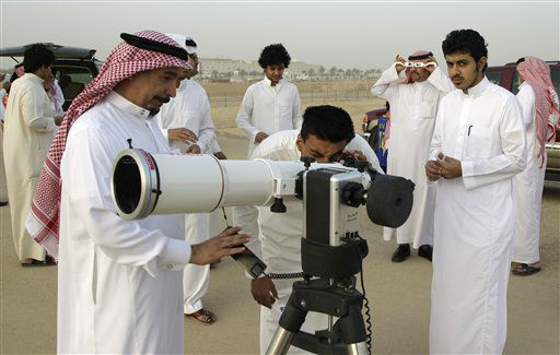 Saudi men use a special telescope and  special protective viewing glasses to observe the transit of Venus at the capital Riyadh, Saudi Arabia, Wednesday, June 6, 2012. People around the world turned their attention to the daytime sky on Tuesday and early Wednesday in Asia to make sure they caught the rare sight of the transit of Venus.  &#40;AP Photo&#47;Hassan Ammar&#41; <span class=meta>(AP Photo&#47; Hassan Ammar)</span>