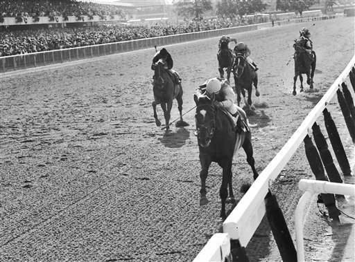 FILE - In this June 7, 1969, file photo, Arts and Letters and jockey Braulio Baeza, front, passes Majestic Prince and jockey Bill Hartack, left, to win the Belmont Stakes horse race at Belmont Park in Elmont, N.Y. Hartack was criticized by many for moving too late in the stretch in the loss to Arts and Letters. As I&#39;ll Have Another prepares to attempt to win the Belmont Stakes in his quest to become the 12th Triple Crown champion and first in 34 years on Saturday, June 9, 2012, The Associated Press takes a look at some of the 19 horses who won the Kentucky Derby and the Preakness, but came up short in the final leg of the Triple Crown, and how the race unfolded. &#40;AP Photo, File&#41; <span class=meta>(AP Photo&#47; Uncredited)</span>