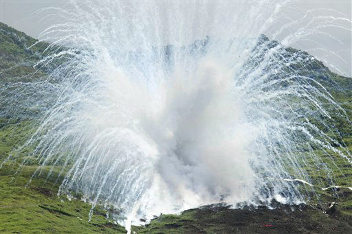 A white phosphorous shell explodes on target during the &#34;Lien Yung&#34; annual joint forces exercises, Thursday, June 7, 2012 in Pingtung County, southern Taiwan. &#40;AP Photo&#47;Wally Santana&#41; <span class=meta>(AP Photo&#47; Wally Santana)</span>