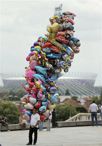 A vendor offers balloons on Zamkowy Square, with the National Stadium inbackground, during the Euro 2012 soccer championship in Warsaw, Poland, Thursday, June 7, 2012. &#40;AP Photo&#47;Gero Breloer&#41; <span class=meta>(AP Photo&#47; Gero Breloer)</span>