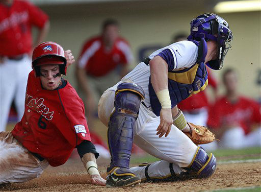 Stony Brook&#39;s Travis Jankowski &#40;6&#41; scores as he slides home behind LSU catcher Ty Ross &#40;26&#41; on a sacrifice fly by Kevin Krause in the 11th inning of an NCAA college baseball tournament super regional game in Baton Rouge, La., Friday, June 8, 2012. &#40;AP Photo&#47;Gerald Herbert&#41; <span class=meta>(AP Photo&#47; Gerald Herbert)</span>