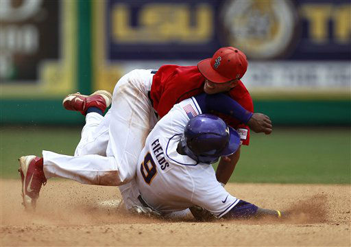 LSU outfielder Arby Fields &#40;9&#41; is tagged out at second base by Stony Brook shortstop Cole Peragine &#40;28&#41; in the sixth inning of an NCAA college baseball tournament super regional game in Baton Rouge, La., Friday, June 8, 2012. &#40;AP Photo&#47;Gerald Herbert&#41; <span class=meta>(AP Photo&#47; Gerald Herbert)</span>