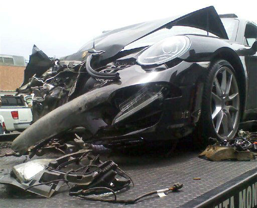 "<div class=""meta ""><span class=""caption-text "">Lindsay Lohan's crashed Porsche lies on a flatbed tow truck, after it collided with a truck on Pacific Coast Highway in Santa Monica, Calif., Friday, June 8, 2012. Santa Monica police say the accident occurred around 11:45 a.m. and an investigation is ongoing. Lindsay Lohan's spokesman says the actress is fine after being released from an area hospital. (AP Photo) (AP Photo/ Uncredited)</span></div>"