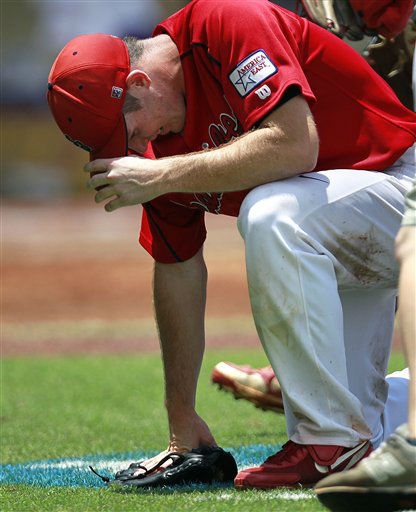 Stony Brook pitcher Tyler Johnson kneels in the ground after he pitched a 3-hit complete game to defeat LSU 3-1 in their second NCAA college baseball tournament super regional game in Baton Rouge, La., Saturday, June 9, 2012. The series is tied 1-1 and they will play the final game Sunday. &#40;AP Photo&#47;Gerald Herbert&#41; <span class=meta>(AP Photo&#47; Gerald Herbert)</span>