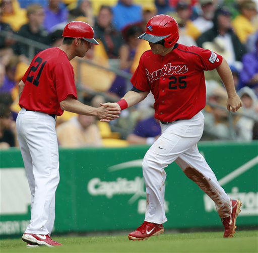 Stony Brook&#39;s Kevin Courtney &#40;25&#41; is greeted by Stony Brook assistant coach Joe Pennucci &#40;21&#41; at third base on a solo homer in the fifth inning of an NCAA college baseball tournament super regional game in Baton Rouge, La., Saturday, June 9, 2012. Stony Brook won 3-1. &#40;AP Photo&#47;Gerald Herbert&#41; <span class=meta>(AP Photo&#47; Gerald Herbert)</span>