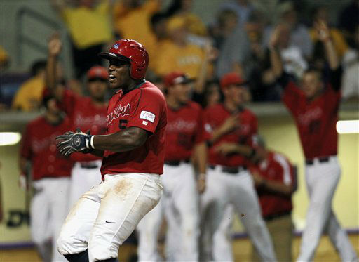 Stony Brook&#39;s William Carmona &#40;5&#41; reacts after scoring on a two-run RBI by Maxx Tissenbaum against LSU in the fourth inning of an NCAA college baseball tournament super regional game in Baton Rouge, La., Sunday, June 10, 2012. &#40;AP Photo&#47;Gerald Herbert&#41; <span class=meta>(AP Photo&#47; Gerald Herbert)</span>