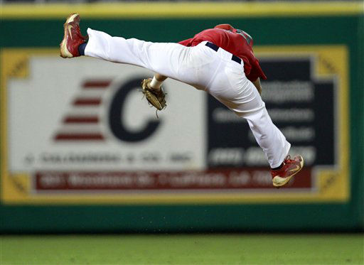 Stony Brook shortstop Cole Peragine &#40;28&#41; leaps to grab a high line drive by LSU&#39;s Mason Katz in the eighth inning of an NCAA college baseball tournament super regional game in Baton Rouge, La., Sunday, June 10, 2012. Stony Brook won 7-2 and advances to the College World Series. &#40;AP Photo&#47;Gerald Herbert&#41; <span class=meta>(AP Photo&#47; Gerald Herbert)</span>