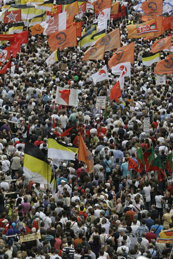 Demonstrators hold the flags of various groups during a massive protest against Putin&#39;s rule in Moscow, Tuesday, June 12, 2012. Thousands of Russians are gathering Tuesday for the first massive protest against President Vladimir Putin&#39;s rule since his inauguration as investigators summoned several key opposition figures for questioning in an apparent bid to disrupt the rally.&#40;AP Photo&#47;Mikhail Metzel&#41; <span class=meta>(AP Photo&#47; Mikhail Metzel)</span>