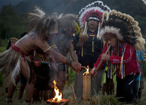 Indigenous from several tribes participate in the Sacred Fire Lighting Ceremony at the Kari-Oca village, during the United Nations Conference on Sustainable Development, or Rio&#43;20, in Rio de Janeiro, Brazil, Wednesday, June 13, 2012. The United Nations&#39; largest-ever conference has kicked off in Rio de Janeiro. The event runs through June 22, with three final days of high-profile talks among some 130 top leaders from nations around the globe. &#40;AP Photo&#47;Felipe Dana&#41; <span class=meta>(AP Photo&#47; Felipe Dana)</span>