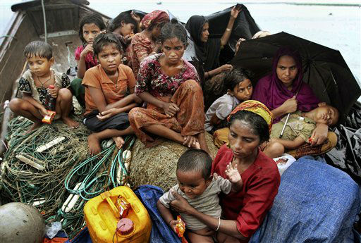 "<div class=""meta ""><span class=""caption-text "">Rohingya Muslims who fled Myanmar to Bangladesh to escape religious violence, sit in a boat after being intercepted crossing the Naf River by Bangladesh border authorities in Taknaf, Bangladesh, Wednesday, June 13, 2012. Bangladesh has turned back more than 1,500 refugees in recent days, officials said and a global human rights group on Wednesday urged Bangladesh to keep its border open to people seeking refuge from sectarian violence in western Myanmar.(AP Photo/Anurup Titu) (AP Photo/ Anurup Titu)</span></div>"