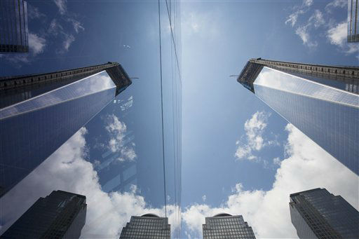 One World Trade Center, right, is reflected in the glass surface of the National September 11 Museum, Thursday, June 14, 2012 in New York. President Barack Obama is scheduled to visit the site later Thursday. &#40;AP Photo&#47;Mark Lennihan&#41; <span class=meta>(AP Photo&#47; Mark Lennihan)</span>