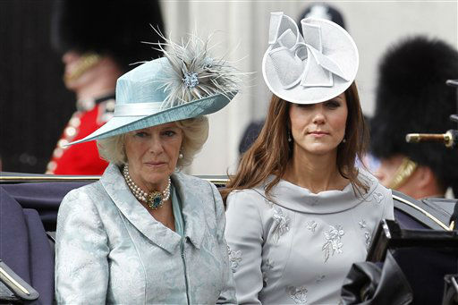 "<div class=""meta ""><span class=""caption-text "">Britain's Camilla, Duchess of Cornwall, left, and Kate, Duchess of Cambridge leave Buckingham Palace on a horse drawn carriage for the Trooping The Colour at the Horse Guards Parade in London, Saturday, June 16, 2012. (AP Photo/Sang Tan) (AP Photo/ Sang Tan)</span></div>"