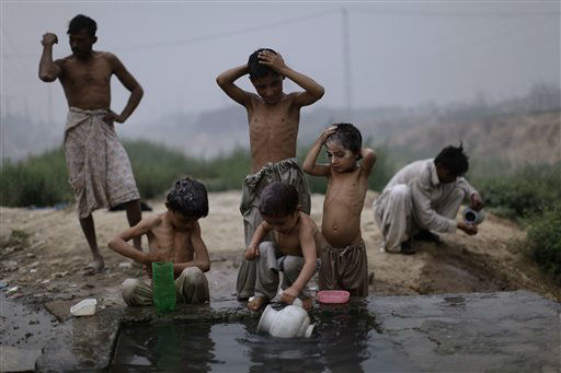 "<div class=""meta ""><span class=""caption-text "">Pakistani children shower at a water reservoir, on the outskirts of Islamabad, Pakistan, Monday, June 18, 2012. (AP Photo/Muhammed Muheisen) (AP Photo/ Muhammed Muheisen)</span></div>"