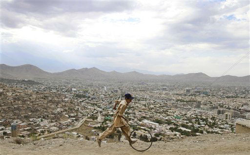 "<div class=""meta ""><span class=""caption-text "">An Afghan boy pushes a wheel on a hill in Kabul, Afghanistan, Tuesday, June, 19, 2012. (AP Photo/Ahmad Jamshid) (AP Photo/ Ahmad Jamshid)</span></div>"