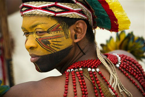 "<div class=""meta ""><span class=""caption-text "">A Pataxo Indian waits to participate in the building of a human banner on Flamengo beach, organized by Amazon Watch, on the sidelines of the Rio+20, or UN Conference on Sustainable Development in Rio de Janeiro, Brazil, Tuesday, June 19, 2012. The activists are calling attention to threats posed to rivers, forests and livelihoods by large hydroelectric dams, like the Belo Monte hydroelectric plant being constructed in Brazil's Amazon. (AP Photo/Victor R. Caivano) (AP Photo/ Victor R. Caivano)</span></div>"