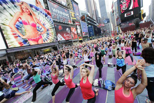 Thousands of yoga enthusiasts convene in New York&#39;s Times Square to mark the summer solstice, Wednesday, June 20, 2012. Temperatures are expected to be near 100 degrees &#40;37C&#41; Wednesday. &#40;AP Photos&#47;Mark Lennihan&#41; <span class=meta>(AP Photo&#47; Mark Lennihan)</span>