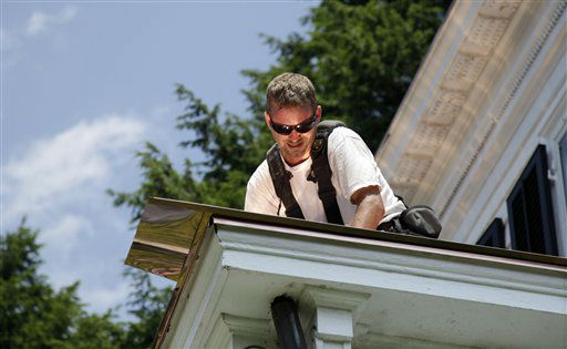 Eric Bottomer, of Horsham, Pa.,  puts a copper roof on 112 Mercer Street, as temperatures reach the 90&#39;s in Princeton, N.J., Wednesday, June 20, 2012. Bottomer says the copper roof will be good for 90 years on the house that was home to Albert Einstein for 20 years until his death in April 1955. &#40;AP Photo&#47;Mel Evans&#41; <span class=meta>(AP Photo&#47; Mel Evans)</span>
