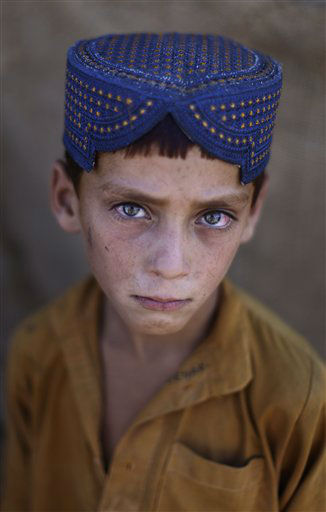"<div class=""meta ""><span class=""caption-text "">Afghan refugee Ibraheem Rahees, 6, is seen in a slum, on World Refugee Day, on the outskirts of Islamabad, Pakistan, Wednesday, June 20, 2012. The Pakistani government and the United Nations refugee agency reached an agreement in March 2009 to allow some 1.7 million registered Afghan refugees living in Pakistan to continue sheltering there until at least 2012, thousands of them still live without electricity, running water and other basic services. (AP Photo/Muhammed Muheisen)</span></div>"