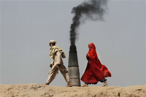"<div class=""meta ""><span class=""caption-text "">An Afghan couple walk to in front of a brick factory in Surkh Rod district of Jalalabad east of Kabul, Afghanistan, Thursday, June 21, 2012. (AP Photo/Rahmat Gul)</span></div>"