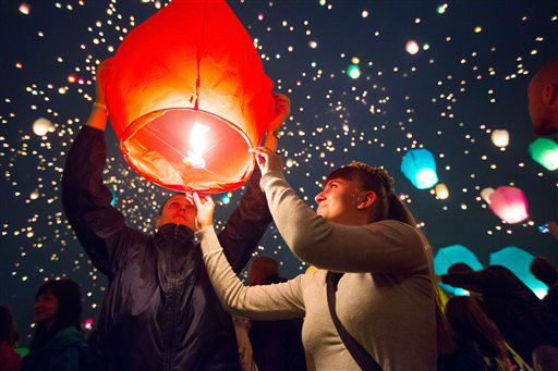 "<div class=""meta ""><span class=""caption-text "">In this photo taken Thursday, June 21, 2012, people release lanterns in Poznan, Poland. Thousands of lanterns were released to mark the shortest night of the year. (AP Photo) (AP Photo/ STR)</span></div>"