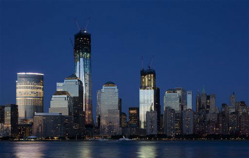 "<div class=""meta image-caption""><div class=""origin-logo origin-image ""><span></span></div><span class=""caption-text"">In a photo made Saturday, June 23, 2012, construction cranes perch on top of One World Trade Center, left, and Four World Trade Center in New York. (AP Photo/Mark Lennihan) (AP Photo/ Mark Lennihan)</span></div>"