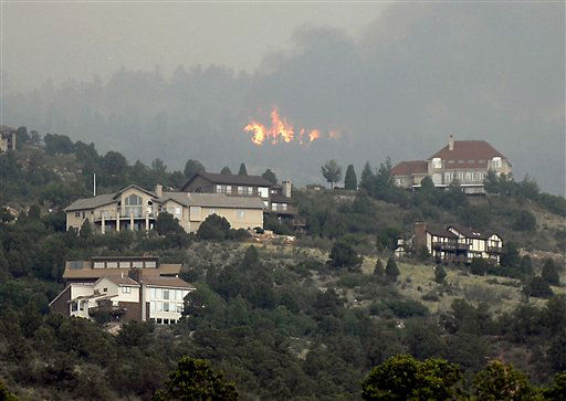 A wildfire burns near Colorado Springs, Colo., on Sunday, June 24, 2012. The fire erupted and grew out of control to more than 3 square miles early Sunday, prompting the evacuation of more than 11,000 residents and an unknown number of tourists. &#40;AP Photo&#47;Bryan Oller&#41; <span class=meta>(AP Photo&#47; Bryan Oller)</span>