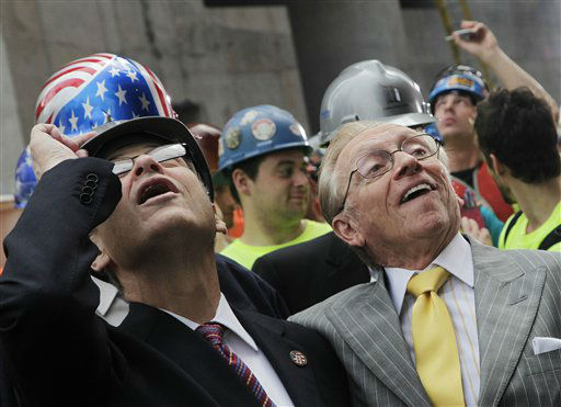 New York State Assembly Speaker Sheldon Silver, left, and developer Larry Silverstein watch as the ceremonial last beam is hoisted to the top of Four World Trade Center, Monday, June 25, 2012.. The 72-floor, 977-foot tower is scheduled to open late next year. It&#39;s expected to be the first tower completed on the 16-acre site since the 9&#47;11 attacks. &#40;AP Photo&#47;Mark Lennihan&#41; <span class=meta>(AP Photo&#47; Mark Lennihan)</span>