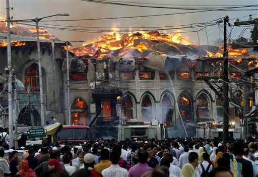 "<div class=""meta ""><span class=""caption-text "">Kashmiri residents watch as firefighters try to extinguish a fire at the nearly 200-years-old Sheikh Abdul Qadir Jeelani Shrine, popularly known as Ghaus-e-Azam, or Dastgeer Sahab, in downtown Srinagar, India, Monday, May 25, 2012. Anti-India clashes between protesters and government forces erupted in the main city in Indian-controlled Kashmir Monday after the highly revered Muslim shrine was destroyed in the fire, police said. The cause of the fire is yet unknown. (AP Photo/Dar Yasin) (AP Photo/ Dar Yasin)</span></div>"