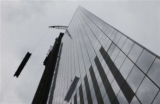 "<div class=""meta ""><span class=""caption-text "">A load of steel is hoisted to the top of Four World Trade Center, Monday, June 25, 2012. The 72-floor, 977-foot tower is scheduled to open late next year. It's expected to be the first tower completed on the 16-acre site since the 9/11 attacks. (AP Photo/Mark Lennihan) (AP Photo/ Mark Lennihan)</span></div>"