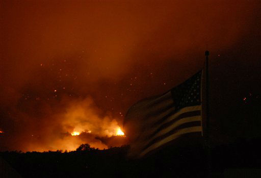"<div class=""meta ""><span class=""caption-text "">Flames from the Waldo Canyon Fire cause the western side of Colorado Springs, Colo. to glow as  several structures and home burn on Tuesday, June 26, 2012.  The fire made a massive run late in the day leaving a trail of destruction, and burning homes and buildings in it's path.  Heavily populated areas in the fire's path have been affected.   (AP Photo/Bryan Oller) (AP Photo/ Bryan Oller)</span></div>"