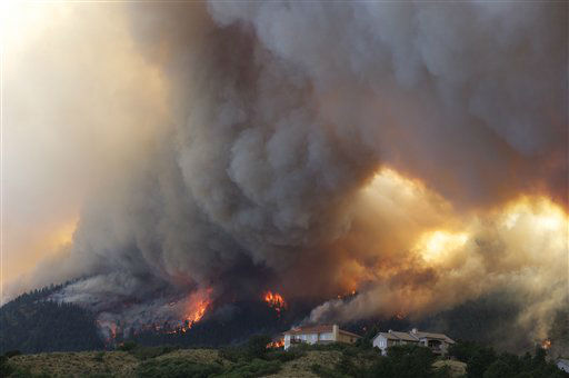 "<div class=""meta ""><span class=""caption-text "">Fire from the Waldo Canyon wildfire burns as it moved into subdivisions and destroyed homes in Colorado Springs, Colo., on Tuesday, June 26, 2012. (AP Photo/Gaylon Wampler) (AP Photo/ Galon Wampler)</span></div>"