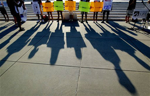 "<div class=""meta ""><span class=""caption-text "">Protestors shadows are cast outside the Supreme Court in Washington, Thursday, June 28, 2012, in Washington, as the Supreme Court is expected to announce its verdict on President Barack Obama's health care law. (AP Photo/David Goldman) (AP Photo/ David Goldman)</span></div>"