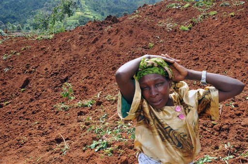 A woman cries for her four children she lost in a landslide in Bududa,  about 250kms east of Uganda capital Kampala Tuesday June 26, 2012. Massive landslides induced by torrential rains destroyed three villages in the mountainous district of Bududa in eastern Uganda Monday, killing scores of people officials said. &#40;AP Photo &#47; Stephen Wandera&#41; <span class=meta>(AP Photo&#47; Stephen Wandera)</span>