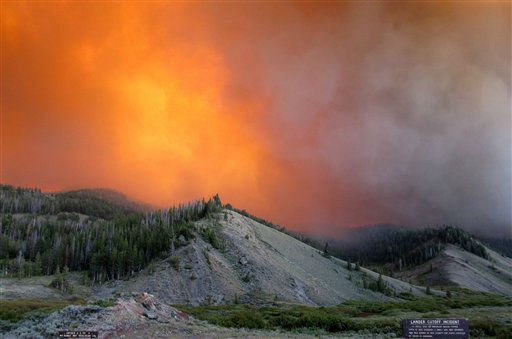 This Tuesday, June 26, 2012 photo provided by the U.S. Forest Service shows the Fontenelle Fire burning in the Bridger-Teton National Forest, Wyo. U.S. Forest Service spokeswoman Mary Cernicek said the Fontenelle Fire ? the first major wildfire of the season in western Wyoming ? grew from about 300 acres to 2,000 acres on Tuesday due to strong winds. There was no containment as of Wednesday despite the efforts of about 90 firefighters. &#40;AP Photo&#47;U.S. Forest Service&#41; <span class=meta>(AP Photo&#47; Uncredited)</span>