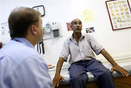 Patient Luis Gutierrez, right, talks with Dr. Javier Hiriart at Camillus Health Concern, Wednesday, June 27, 2012, in Miami. Camillus is a private, non-profit organization that provides health care to the homeless and poor in Miami-Dade County. Presidential candidates, governors of virtually every state, insurers with billions at stake, companies large and small and countless millions of Americans concerned about their own medical care and how they&#39;ll pay for it are awaiting a Supreme Court ruling expected Thursday on whether or not the Affordable Care Act passes the test of constitutionality.&#40;AP Photo&#47;Lynne Sladky&#41; <span class=meta>(AP Photo&#47; Lynne Sladky)</span>