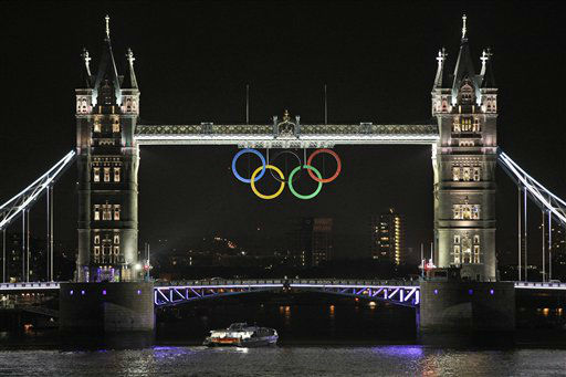 "<div class=""meta ""><span class=""caption-text "">The Olympic rings are seen atop the iconic Tower Bridge over river Thames in London, coinciding with one month to go until the start of the London 2012 Games, Wednesday, June 27, 2012. The giant rings, which are fully retractable to allow for tall ships to pass through the bridge, will remain in position for the duration of the Games. (AP Photo/Lefteris Pitarakis) (AP Photo/ Lefteris Pitarakis)</span></div>"