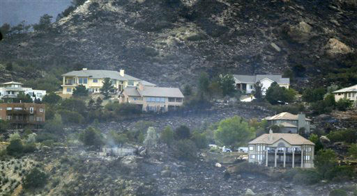 "<div class=""meta image-caption""><div class=""origin-logo origin-image ""><span></span></div><span class=""caption-text"">Smoke rises from the ruins of a home while other homes in the development still stand after a wildfire rolled through housing subdivisions in the mountains north and west of Colorado Springs, Colo., on Wednesday, June 27, 2012. The fire has forced the evacuation of more than 32,000 residents of the communities west of and now in Colorado Springs proper. (AP Photo/David Zalubowski) (AP Photo/ David Zalubowski)</span></div>"