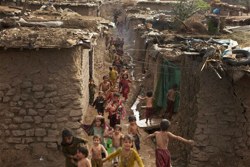 Pakistani children living in Islamabad&#39;s slums run in Pakistan, Wednesday, June 27, 2012. &#40;AP Photo&#47;B.K. Bangash&#41; <span class=meta>(AP Photo&#47; B.K. Bangash)</span>