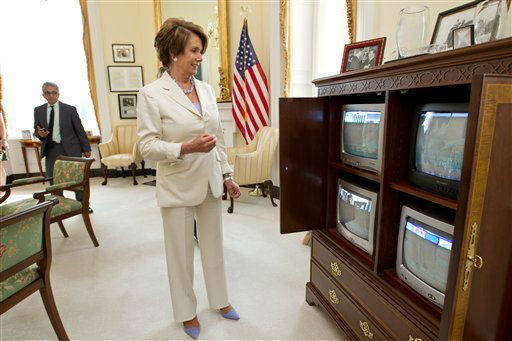"<div class=""meta ""><span class=""caption-text "">House Minority Leader Nancy Pelosi of Calif., smiles as she watches the breaking news from the Supreme Court which upheld the Affordable Care Act, Thursday, June 28, 2012 on Capitol Hill in Washington. Pelosi, the former speaker of the House, was instrumental in helping to pass health care reform in Congress and was at President Obama's side when he signed it into law.  (AP Photo/J. Scott Applewhite) (AP Photo/ J. Scott Applewhite)</span></div>"