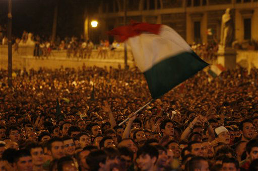 "<div class=""meta ""><span class=""caption-text "">Italian soccer fans celebrate in Piazza del Popolo square in Rome, after Italy's second goal against Germany in the Euro 2012 soccer championship semifinal match Thursday, June 28, 2012. (AP Photo/Alessandra Tarantino)</span></div>"