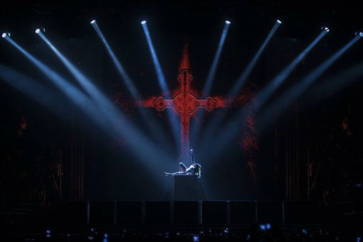U.S. singer Madonna performs during her 'MDNA' tour in Berlin, Thursday, June 28, 2012. (AP Photo/Markus Schreiber)