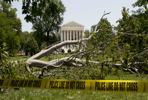 "<div class=""meta ""><span class=""caption-text "">An American beech tree lies on Capitol Hill grounds in Washington, Saturday, June 30, 2012, in front of the U.S. Supreme Court, background, after a powerful storm swept across the Washington region late Friday.  Violent storms swept across the eastern U.S., killing at least nine people and knocking out power to hundreds of thousands on a day that temperatures across the region are expected to reach triple-digits.  (AP Photo/Manuel Balce Ceneta) (AP Photo/ Manuel Balce Ceneta)</span></div>"