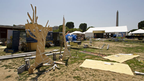 Damaged exhibit for the Smithsonian Folklife Festival litter the National Mall near the Washington Monument, background, in Washington Saturday, June 30, 2012 after a powerful storm swept across the Washington region late Friday.   &#40;AP Photo&#47;Manuel Balce Ceneta&#41; <span class=meta>(AP Photo&#47; Manuel Balce Ceneta)</span>