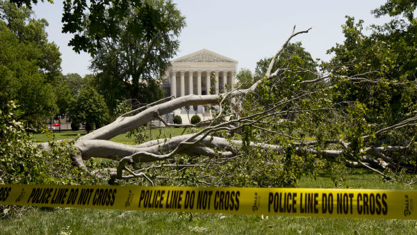 "<div class=""meta ""><span class=""caption-text "">An American beech tree is down on Capitol Hill grounds in Washington Saturday, June 30, 2012 across theU.S. Supreme Court, background, after a powerful storm swept across the Washington region late Friday.   Violent storms swept across the eastern U.S., killing at least nine people and knocking out power to hundreds of thousands on a day that temperatures across the region are expected to reach triple-digits.  (AP Photo/Manuel Balce Ceneta) (AP Photo/ Manuel Balce Ceneta)</span></div>"