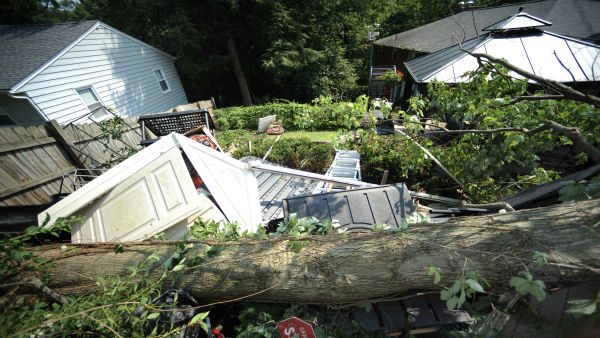 "<div class=""meta ""><span class=""caption-text "">A tree lays on top of a storage building at the home Saturday, June 30, 2012 in Charleston, W.Va.  Violent storms swept across the eastern U.S., killing at least nine people and knocking out power to hundreds of thousands on a day that temperatures across the region are expected to reach triple-digits.  Officials said about 500,000 people were without power in West Virginia. (AP Photo/Jeff Gentner) (AP Photo/ Jeff Gentner)</span></div>"