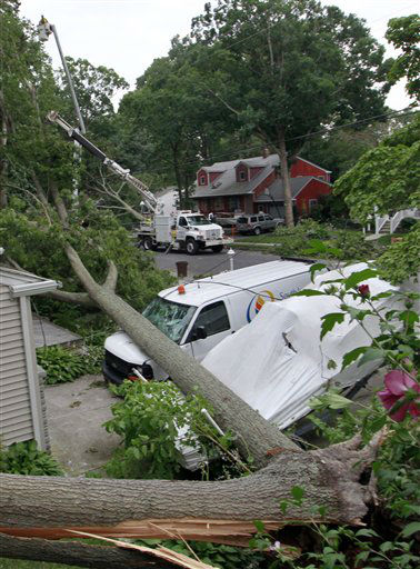 A van and boat sit crushed by fallen trees, as crews work to restore power Saturday, June, 30, 2012, in Northfield, N.J. Severe thunderstorms packing heavy rain, lightning and strong winds that gusted up to 70 mph hit the state Saturday, knocking out power to hundreds of thousands and killing at least two. &#40;AP Photo&#47;Mel Evans&#41; <span class=meta>(AP Photo&#47; Mel Evans)</span>