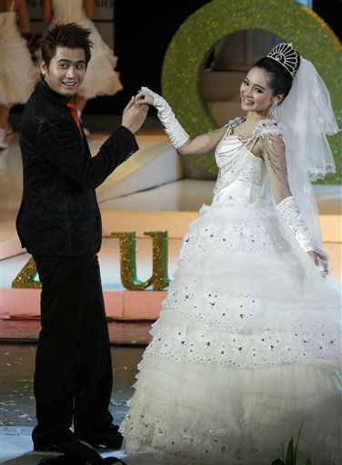 In this photo taken Sunday, July 1, 2012, Myanmar models present a wedding dress and a suit during &#34;The Greatest Wedding Show&#34; by local designers at the National Theater in Yangon, Myanmar. &#40;AP Photo&#47;Khin Maung Win&#41; <span class=meta>(AP Photo&#47; Khin Maung Win)</span>